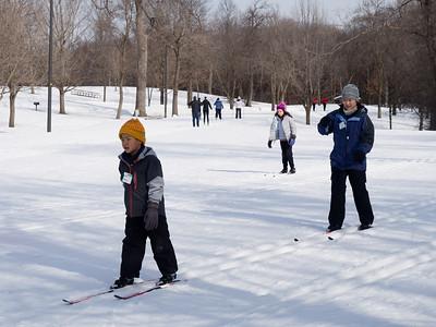 Jianping and Nolan taking a cross country skiing class, Hyland Park