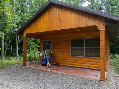 Lindsay checking into her assigned cabin, Camp Olson