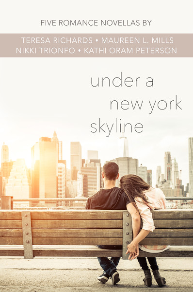 couple relaxing on New york bench in front of the skyline at sun