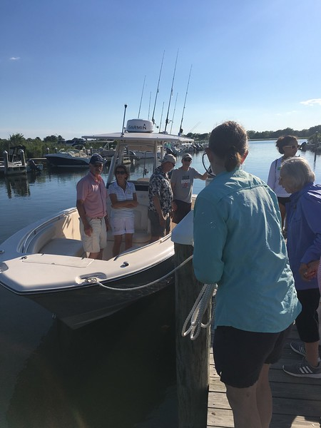 After fishing for a while, our charter returned to the dock to pick up additional passengers., Lilly, Doris, Barbara and Michelle (Chris was back in the hammock napping again)