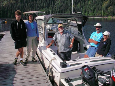 Captain Doug, centre, of Della Falls Water Taxi.