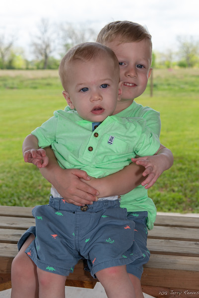 Troy holding his brother Tripp.