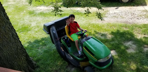 2018-08-10 Dylan First time mowing the lawn