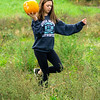 Ellas Carries a Pumpkin with One Hand