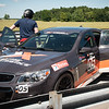 """Putnam Park, Indiana - Connor's birthday visit to Xtreme Xperience to drive super cars on August 9, 2019. Connor and Sinead after their 3 laps in the """"safety car""""."""