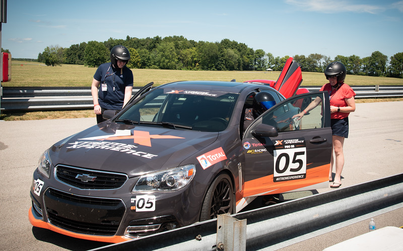 """Putnam Park, Indiana - Connor's birthday visit to Xtreme Xperience to drive super cars on August 9, 2019. Connor and Sinead getting into the """"safety car"""" to take 3 laps."""