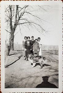 """Ester Long """"cousin"""", Robert Howell, Edith Howell, Alice Howell & Dog, Lillian Howell. On farm in Iowa (Meyers). All before marriage of any of these about 1930 or later. Howard Davis took this picture. Lillian still in 8th grade school before 1936."""