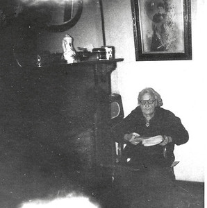 Kay-148: Emily (Granny) McKeown at 203 Cupar Street. Note the picture above her. This picture is of Emily in her 20s and is now in David's possession