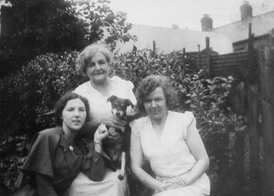 Kay-103: The back reads: In the garden with Terry (the dog) May (Maisie) ,Emily (Granny), Florence (Florrie)  at 203 Cupar Street.