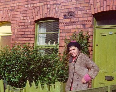 DPB-230: Lizzie McKeown leaving 203 Cupar Street, Blefast