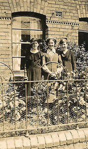 DPB-231: May (Maisie) McKeown with two friends standing outside 203 Cupar Street, Belfast