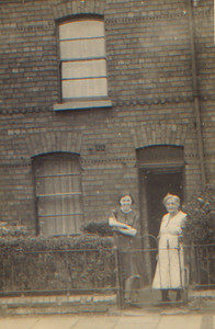 Kay-47: May (Maisie) McKeown and Emily (Granny) McKeown outside 203 Cupar St. Belfast The back reads:...The moral of all of this is SAVE your money and invest in War Saving Certificates...but think it will be a long and hard fight... Love Liz (Written Lizzie McKeown)