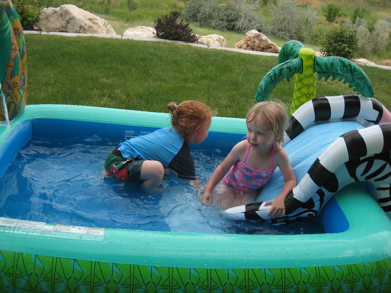 Sophie and Evelyn in the pool.