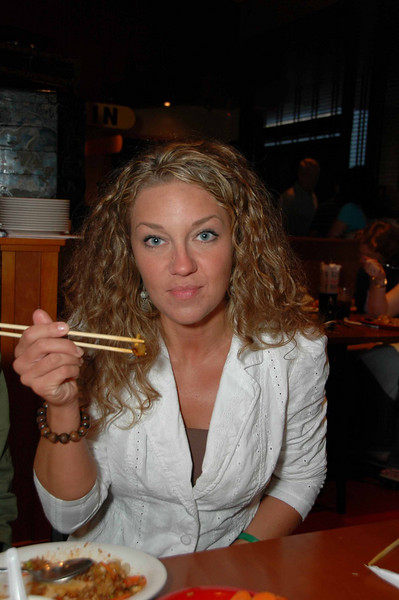 "A group gathered recently at Pei Wei restaurant for Karina's ""annual 29th birthday"" celebration. We should change it to ""annual 25th"" celbration because she honestly does not look a day over 25. In this photo, Karina demonstrates her eating-with-chopsticks skills. Very impressive."