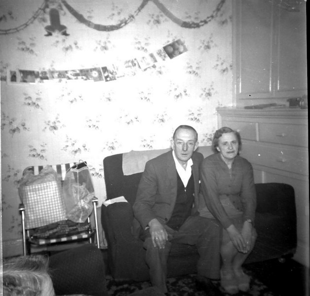 Ernest Bessie Chadwick in front room of 325 Burnley Rd abt 1960