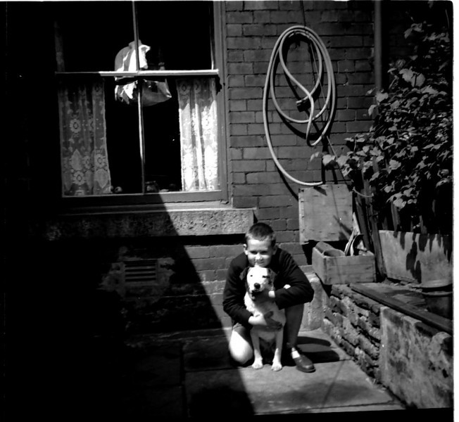 Peter and Scamp Fisher abt 1960 Back yard 325 Burnley Rd Note Budgie cage in Window