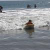 Kathy takes a wave