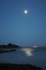 Full moon rise over bay.