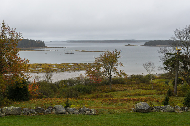 The view from the deck is across Eggemoggen Reach which separates the Blue Hill Peninsula from Deer Isle.  This is called the Great Cove.