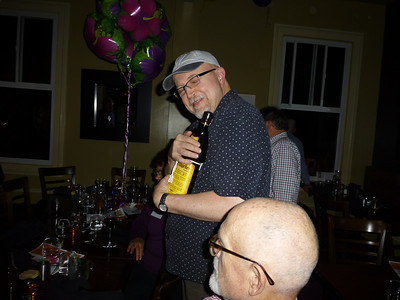 Guests at the Birthday Party: Tony slipping away with the booze while David watches.