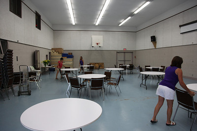 Getting the hall ready (Seventh Day Adventist church hall in Chilliwack).  Where are the men?