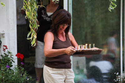 Dorothy carry's Darlene's Birthday cake (55 candles?)