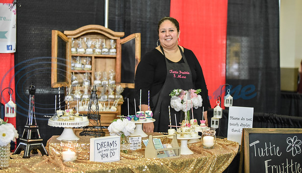 Eva Alfaro smiles for a photo at her booth for Tuttie Fruittie & More at the XV Quinceanera Expo on Sunday, June 2. The Expo was the first in Tyler with a fashion show being the main attraction but also included vendors, professional dance performances and make-up demonstrations. (Jessica T. Payne/Tyler Morning Telegraph)
