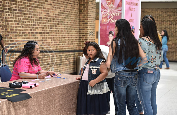 Tyler residents check in at Harvey Hall Convention Center on Sunday, June 2 for the first XV Quinceanera Expo 2019. The included a fashion show, professional dance performances, vendor, food booths, photo booth and raffle giveaways. (Jessica T. Payne/Tyler Morning Telegraph)