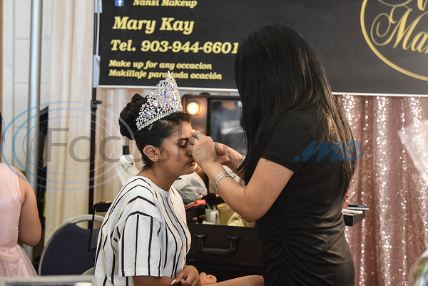 Nansi Gutierrez of Nansi Make-Up does the make-up of Brandy Nunes in preparation of a fashion show at the XV Quinceanera Expo 2019 on Sunday, June 2. The event was the first in Tyler and also included vendors, professional dancers, music and raffle giveaways. (Jessica T. Payne/Tyler Morning Telegraph)
