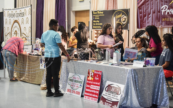 Expo goers sit for hair and make-up demonstrations at the XV Quinceanera Expo 2019 on Sunday, June 2. The event was held at Harvey Hall Convention Center and included a fashion show, professional dance performances, vendors and photo booth. (Jessica T. Payne/Tyler Morning Telegraph)
