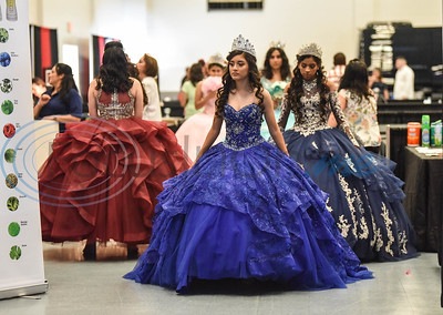 Ballroom gown models get ready for a fashion show at the XV Quinceanera Expo 2019 on Sunday, June 2. The event was held at Harvey Hall Convention Center and included make-up and hair demonstrations, fashion show, vendors and photo booth. (Jessica T. Payne/Tyler Morning Telegraph)