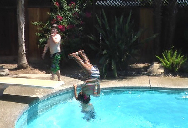 Olivia does a Flip off of the Diving Board