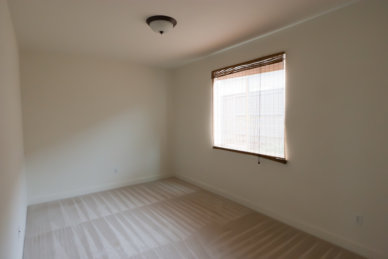 Looking NW into second downstairs bedroom (destined to become office & pooja room)