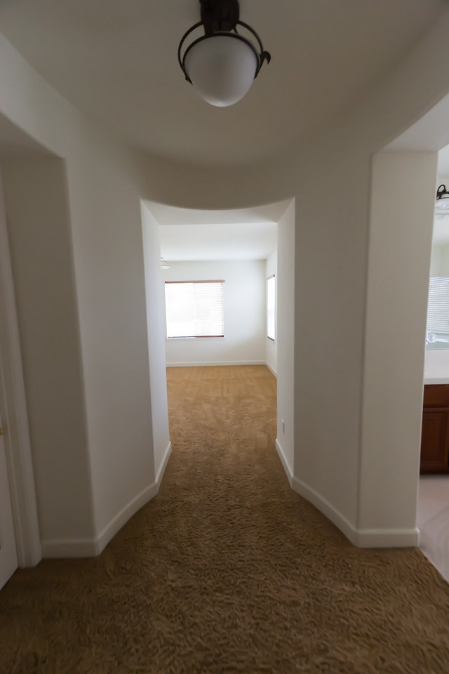 Entryway to master bedroom.  Master closet on left, bedroom straight ahead, and bathroom on right.