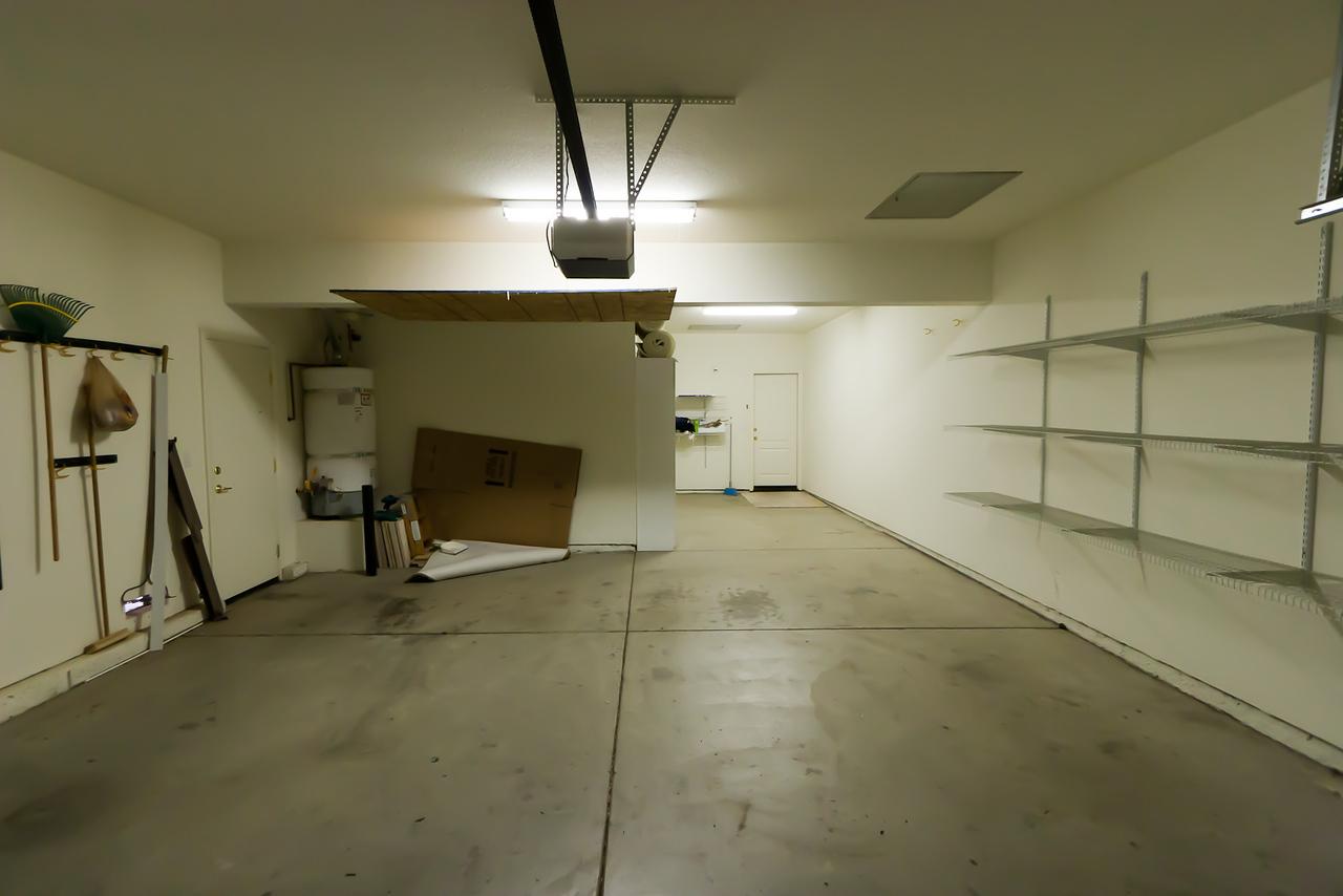 Looking NE into garage from garage door.