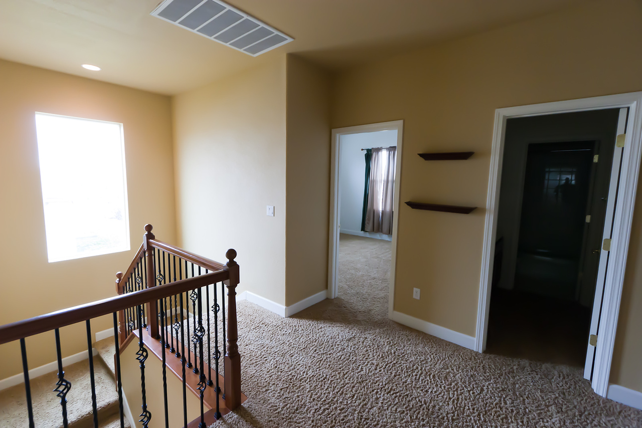 Looking South in upstairs hallway.  Stairway on left, Rithik's room straight ahead, kids bath on right.
