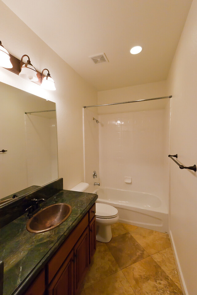 Looking NE into downstairs full bath.  (Copper sink is nice touch)