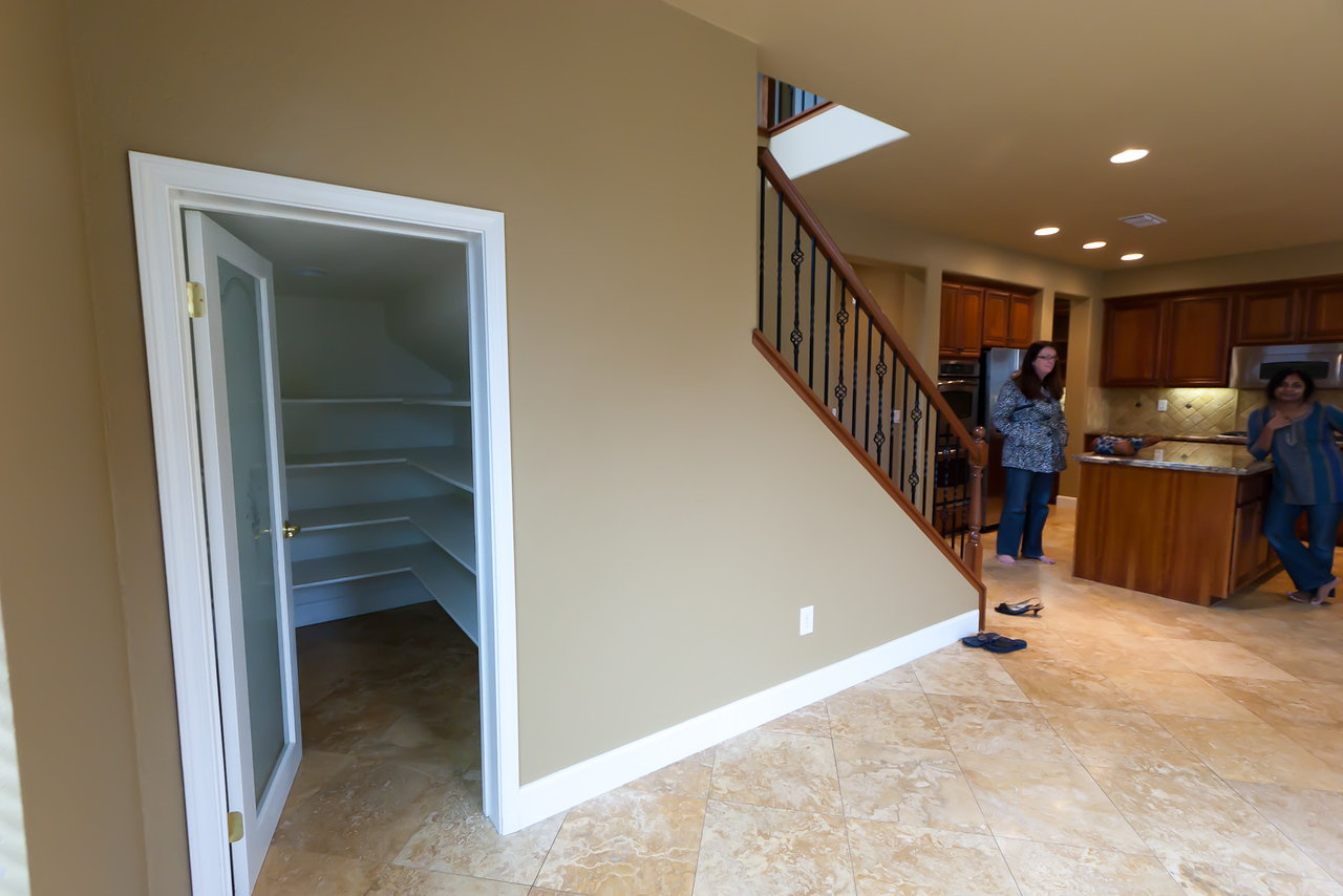 Looking West, from within dining nook, pantry closet on left side under stairs.  This is not a full height closet, maybe 5 feet from floor to ceiling.  Still the extra storage is a nice touch!