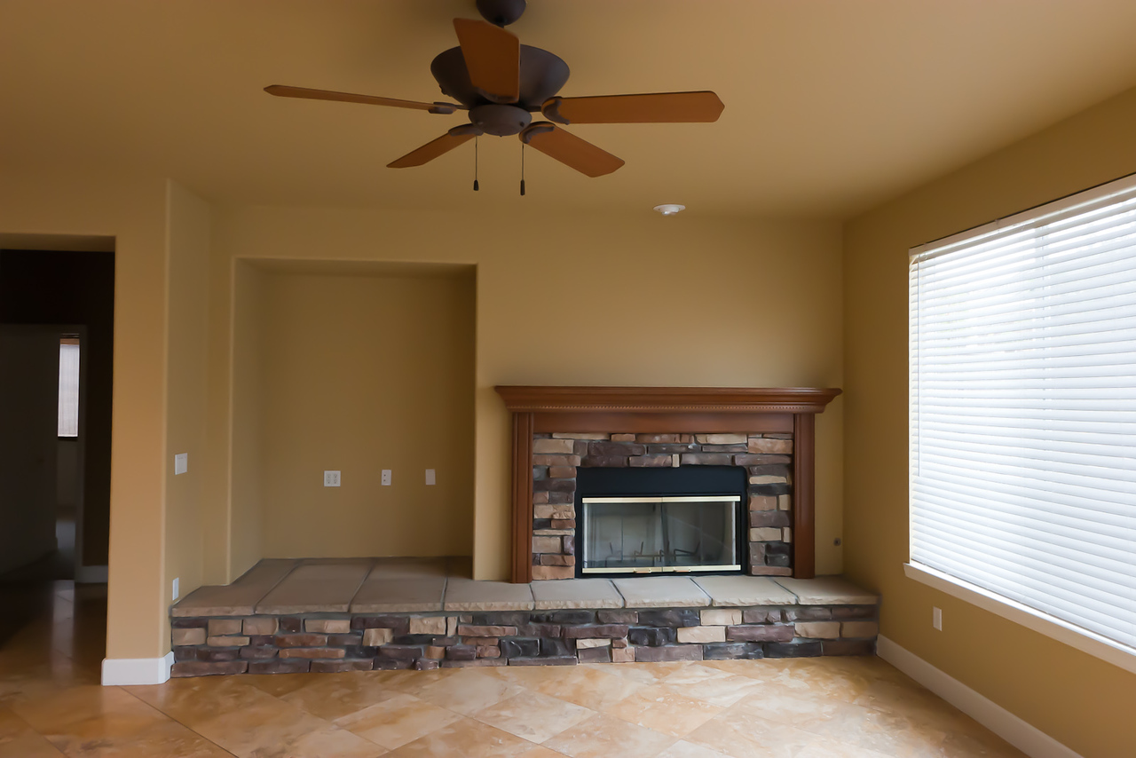 Looking NW at family room fireplace/entertainment alcove.