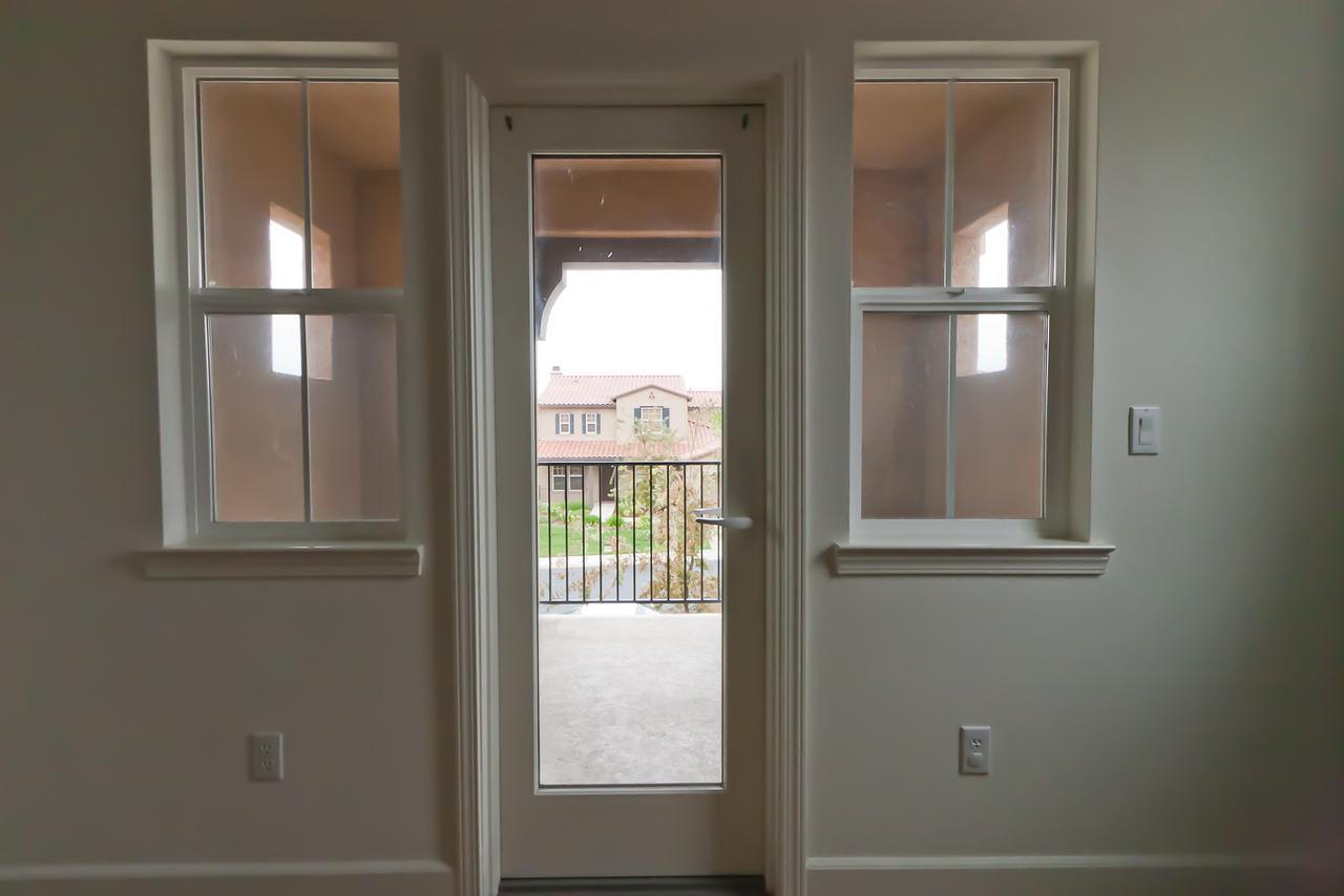 Door to covered balcony in Resya's room.