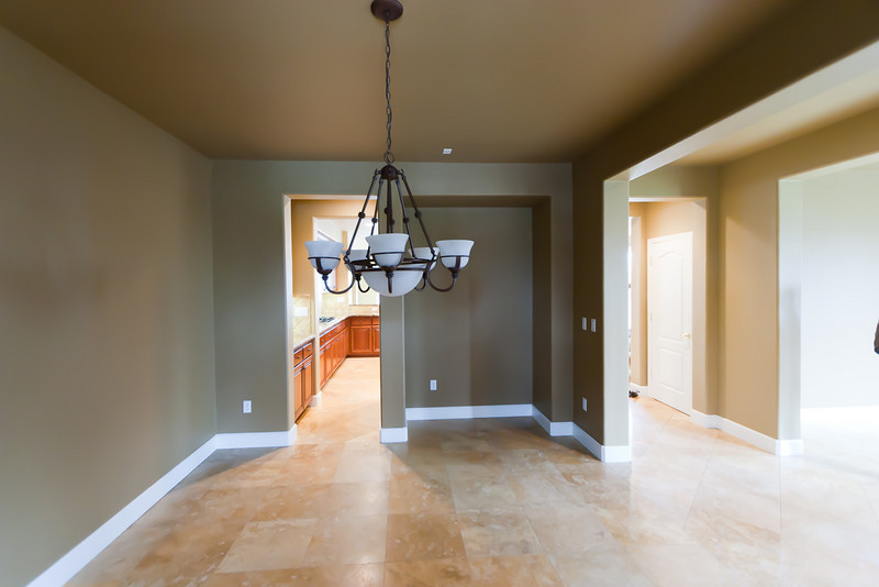 In formal dining, facing NE.  Small hallway into kitchen on left.   Main hallway into kitchen (kitchen on left, nook on right.) on the right side, with hall closet.  Far right is the Formal Living.