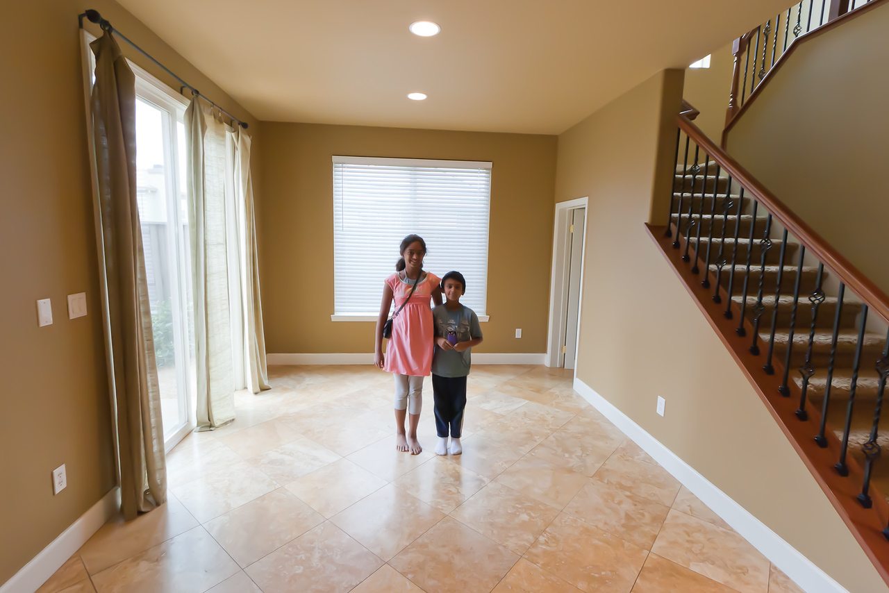 Dining nook area, with kids for scale.  Stairs to upper floor are on left.