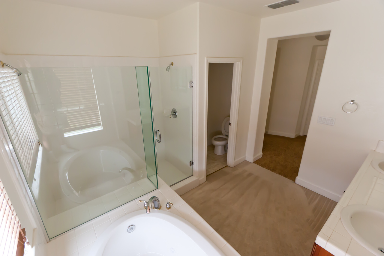 Master bedroom bath, standing over tub.  Note shower has two different shower-heads with separate controls, can be used at same time!  (Oo la la!)