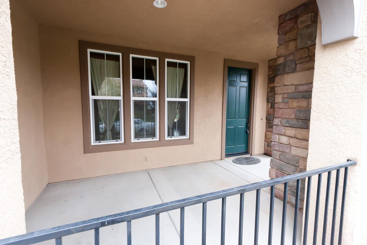 Front patio, front door of house.