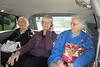 Ginny sandwiched between Barbara and Marie in the third row of seats.