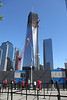 """Near the entrance to the Memorial, 1WTC or sometimes called the """"Freedom Tower"""" or even the """"Liberty Tower"""" dwarfs the other buildings around it.  It had just topped the Empire State Building in height."""