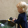 """I learned that Kenna's learned how to use the hose (or, as she says... """"hoash"""").  The plants, pots, and pretty much everything nearby got a good sprayin'."""