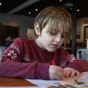 Sammy, coloring. We're out for breakfast at URburger.