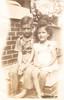 Joyce and Royce on Chipewa porch steps