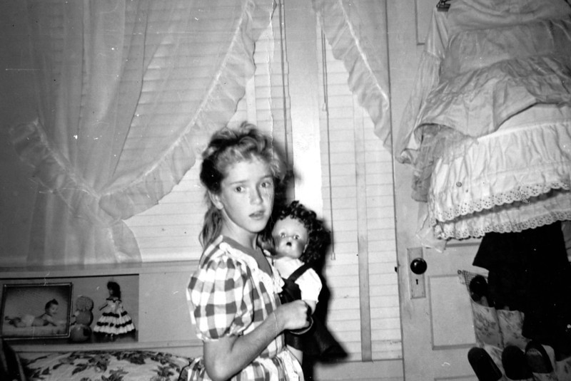 Joyce and her doll on Convention Street